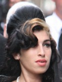 SEE PICS Amy Winehouse holds hands with mystery man