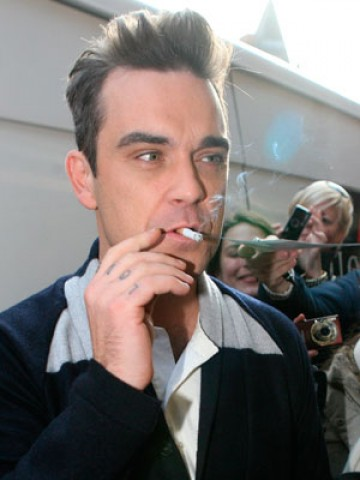 Robbie Williams smoking a cigarette (or weed)