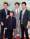 VIDEO Joe, Nick and Kevin Jonas take little brother Frankie to meet Minnie Mouse
