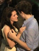 NEW VIDEO Robert Pattinson gives Kristen Stewart a passionate kiss when he thinks no-one's looking