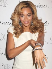 Beyonce Knowles proudly displays her new tattoo - and bling