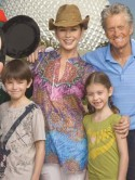 Cancer battler Michael Douglas looks great on family Disney World holiday