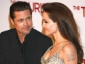 Angelina Jolie and Brad Pitt are loved up at The Tourist premiere in Madrid