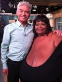 OMG! Annie Hawkins-Turner shows off her 102ZZZ record-breaking breasts to Phillip Schofield