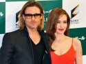 Brad Pitt and Angelina Jolie are loved-up at Japanese premiere of his new film Moneyball