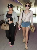 PICTURES of TOWIE's Lydia Bright and Lauren Goodger back from California to frosty Heathrow