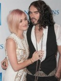 Katy Perry compares her tchotchke' divorce from Russell Brand to a tiny elephant in the room'