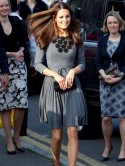 Kate Middleton does her ironing in designer dress with Prince Charles by her side
