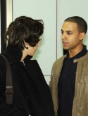 JLS bump into One Direction's Harry Styles at London's Heathrow ahead of flight to US 