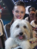 BGT winner Ashleigh Butler smothers Pudsey with pink kisses
