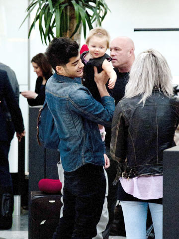 Direction on Zayn Malik And Baby Lux   One Direction   Heathrow London   Pictures