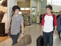 One Direction arrive at London's Heathrow ahead of US tour