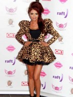 Amy Childs shows off her tan at Fake Bake charity event in Scotland with Peter Andre