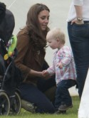 Kate Middleton falls for baby girl as she takes puppy Lupo to watch Prince William in charity polo match