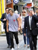 One Direction's Harry Styles hides hair under hat as he hunts for new house in London with Lou Teasdale