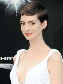 Anne Hathaway stuns in white maxi dress at The Dark Knight Rises film premiere in New York