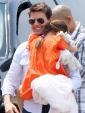 Tom Cruise tries to take Suri's mind off Katie Holmes divorce settlement with helicopter ride in New York