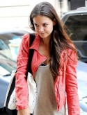 Katie Holmes heads to a New York gym while daughter Suri spends time with Tom Cruise