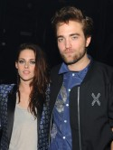 Love cheat Kristen Stewart wears Robert Pattinson's T-shirt to leave LA - as R-Pattz flies in for MTV Video Music Awards