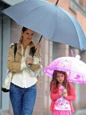 Katie Holmes braves the rain in New York with daughter Suri Cruise