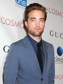 Look away now, Kristen Stewart! Robert Pattinson passionately kisses mystery blonde