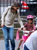 Katie Holmes teaches daughter Suri Cruise how to ride a bike in New York