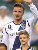 David Beckham is joined by birthday boy Romeo on the pitch at LA Galaxy match
