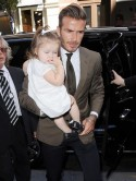 David Beckham brings daughter Harper along to show support at Victoria Beckham Collection launch