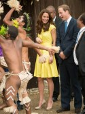 Kate Middleton and Prince William giggle as they're greeted by topless women in the Solomon Islands