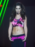 Cheryl Cole flashes sexy toned abs in hot pink crop top on A Million Lights tour