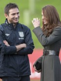 Kate Middleton recycles Reiss coat to meet England football team at launch event with Prince William