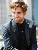 Robert Pattinson promotes the final Twilight film without girlfriend Kristen Stewart