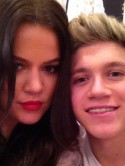 Khloe Kardashian meets 'cuteness' One Direction on US X Factor before London fashion launch with sister Kim