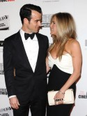 Jennifer Aniston cuddles up to fiance Justin Theroux at LA awards bash in sexy monochrome dress 