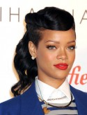 PICS: Rihanna reveals new wet-look 'do on Twitter - or is it a don't?