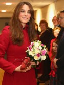 Kate Middleton recycles red LK Bennett coat for rugby date with Prince William in Wales