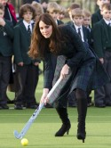 Kate 'Squeak' Middleton plays hockey in high heels on visit to old school without Prince William