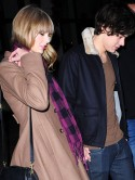 One Direction's Harry Styles gives Taylor Swift New Year's Eve kiss with new moustache