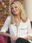 Girls Aloud's Sarah Harding tells Twitter fans she wants to 'raise eyebrows and be understood'