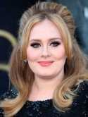 Adele rejects offer to write autobiography because she's too young