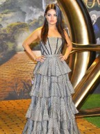 Mila Kunis stuns at Oz The Great And Powerful film premiere in London with James Franco