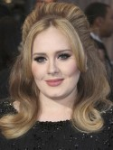 Adele: Robbie Williams is a pro at being a dad - we have fun talking about our babies