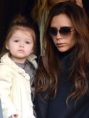 Victoria Beckham takes Harper Seven and her sons to cheer on dad David in Paris football match