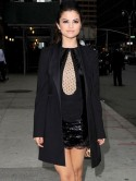 Selena Gomez gets her legs out in sheer black minidress and admits she made Justin Bieber cry