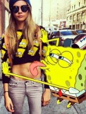 Look away now, Harry Styles! Cara Delevingne gets licked by new man in Twitter photo