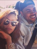 Watch out, Chris Brown! Rihanna snapped kissing mystery man!