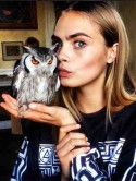 Don't look now, Harry Styles! Cara Delevingne kisses a bird - and it's not 'wifey' Rita Ora