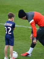 David Beckham trains for Paris Saint-Germain football team with sons Brooklyn, Romeo and Cruz 