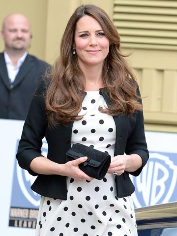 A boy or a girl? After buying a blue baby buggy pregnant Kate Middleton shops for a Moses basket with mum Carole Middleton - now