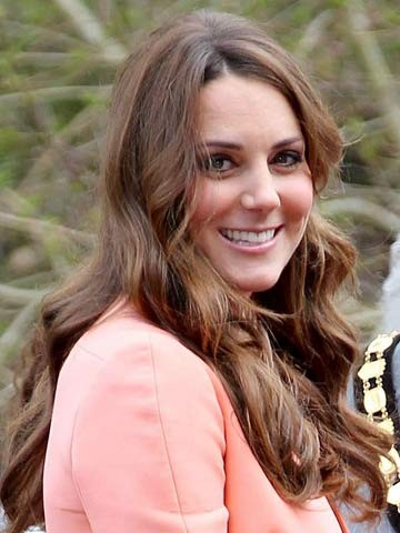 Pregnant Kate Middleton debuts lighter hair colour and soft tumbling waves in time for summer - now